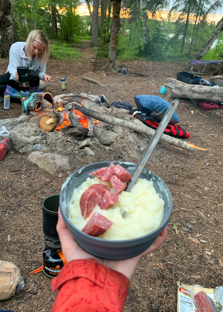 Camp dinner mashed potatoes and salami