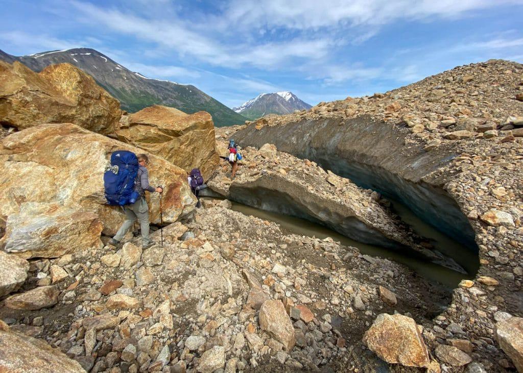 hiking through glacier moraines alaska